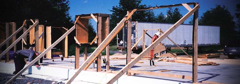 Photo of construction of straw bale home using Nebraska method