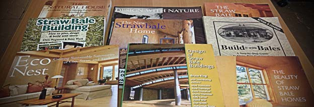 Photo of various books about straw bale home building