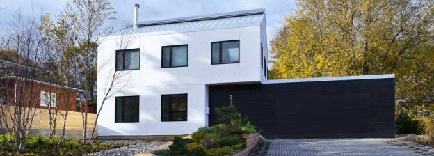 Strawbale & shou sugi ban house with green roof